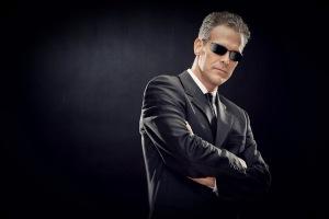 Fashion business man on black background