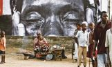 A poster created by French 'urban artivist' JR adorns a public space in Sierra Leone.